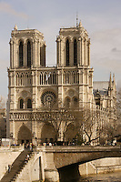 Western Façade (with the Small Bridge in the foreground), Three portals, Kings? Gallery, Rose Window and two towers of 69 meters high, Notre Dame de Paris, 1163 ? 1345, initiated by the bishop Maurice de Sully, Ile de la Cité, Paris, France. Picture by Manuel Cohen