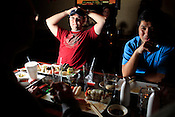 Terence Rhodes considers his options during the Sushi Challenge at Kanki Japanese House of Steaks and Sushi, Durham, NC, March 19, 2012. Rhodes eventually bowed out, many pieces from the finish.