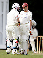 James Warburton (L) and Chris Fletcher of Highgate share a joke during the Middlesex County League Division Three game between Highgate and Barnet B's at Park Road, Crouch End on Sat July 17, 2010
