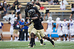 Jaboree Williams (6) and Duke Ejiofor (53) celebrate after a defensive stop during first half action against the Presbyterian Blue Hose at BB&T Field on August 31, 2017 in Winston-Salem, North Carolina.  The Demon Deacons defeated the Blue Hose 51-7.  (Brian Westerholt/Sports On Film)