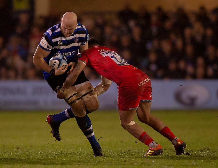 Bath Rugby's Matt Garvey is tackled by Sale Sharks' Denny Solomona<br /> <br /> Photographer Bob Bradford/CameraSport<br /> <br /> Gallagher Premiership Round 9 - Bath Rugby v Sale Sharks - Sunday 2nd December 2018 - The Recreation Ground - Bath<br /> <br /> World Copyright &copy; 2018 CameraSport. All rights reserved. 43 Linden Ave. Countesthorpe. Leicester. England. LE8 5PG - Tel: +44 (0) 116 277 4147 - admin@camerasport.com - www.camerasport.com