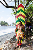 FRENCH POLYNESIA, Tahiti. Moarii Leonie, local surfer at Papenoo Beach.