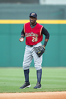 Jose Pirela (28) of the Scranton/Wilkes-Barre RailRiders warms up in the outfield prior to the game against the Charlotte Knights at BB&T Ballpark on July 17, 2014 in Charlotte, North Carolina.  The Knights defeated the RailRiders 9-5.  (Brian Westerholt/Four Seam Images)