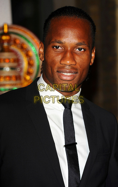 DIDIER DROGBA .Attending Your Moment Is Waiting - launch party at Saatchi Gallery, London, England. September 21st 2010 .portrait headshot black tie white shirt .CAP/CJ.©Chris Joseph/Capital Pictures.