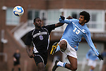 06 December 2008: North Carolina's Ryan Adeleye (13) clears the ball away from Northwestern's Oliver Kupe (8). The University of North Carolina Tar Heels defeated the Northwestern University Wildcats 1-0 at Fetzer Field in Chapel Hill, North Carolina in a NCAA Division I Men's Soccer tournament quarterfinal game.