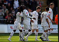 ATTENTION SPORTS PICTURE DESK<br /> Pictured: Jason Scotland of Swansea (2nd L) has his hair pulled by team mate Nathan Dyer (L) while celebrating with team mates after his successful goal from the penalty spot<br /> Re: Coca Cola Championship, Swansea City FC v Norwich City FC at the Liberty Stadium Swansea, south Wales. Saturday 11 April 2009.<br /> Picture by D Legakis Photography / Athena Picture Agency, Swansea 07815441513
