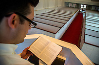 Chris Wong, Assistant Chaplain at the Kentucky Racetrack Chaplaincy, practices reading out loud in the chapel at Southern Baptist Theological Seminary in Louisville, Ky. on April 29, 2014.