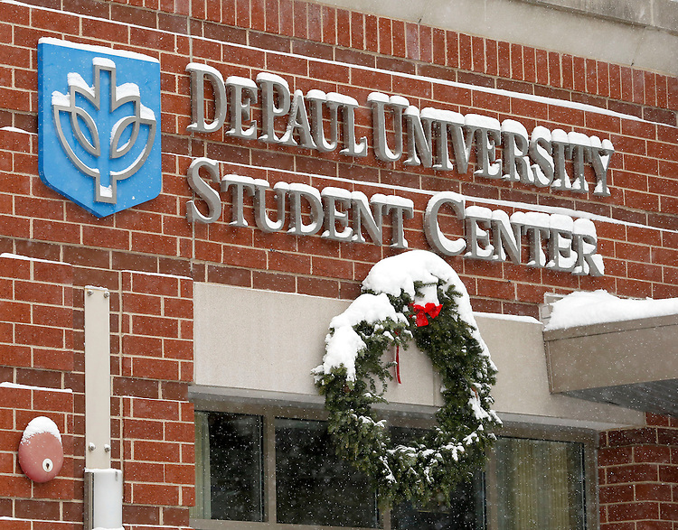 Holiday decorations as the snow falls on the Lincoln Park campus of DePaul University in Chicago as the New Year brought two days of lake effect snow and ice. (Photo by Jamie Moncrief)