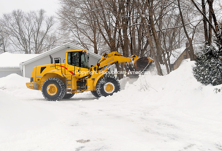 WINSTED, CT, 01 FEBRUARY 2011-020111JS03--A worker uses heavy machinery to clear snow from the parking lot of the Prime Time House campus in Torrington on Tuesday afternoon. <br /> Jim Shannon Republican-American