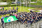 GREEN-FLAG: It was a great day as Betty Stack (principal) of Ardfert NS invited Micheál Ó Muireachtaigh to raiset their 5th Green Flag on Friday as pupils and teachers looked on.