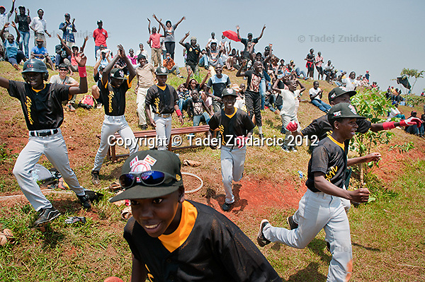 Ugandan players celebrate the victory in Mpigi, Uganda on January 17 2012. They beat Canadian Little League team from Langley 2 to 1 with Felix Barugahare making the winning run on the last play of the game with 2 out.