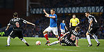 Lee McCulloch tiptoes his way through the maze of Elgin defenders