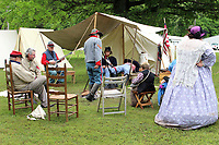 MEGAN DAVIS/MCDONALD COUNTY PRESS Living History Reenactors of all ages with the Turkey Creek Fusiliers gathered around the campfire at their Civil War encampment on Honey Creek Saturday morning. Dressed in era-appropriate attire with weapons of the time, reenactors also recreated a squirmish, complete with cannon blasts.