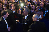 US President Barack Obama (C) waves to supporters while between US Secret Service agents, after delivering remarks on immigration reform, at the Congressional Hispanic Caucus Institute's 37th Annual Awards Gala, in Washington DC, USA, 02 October 2014.<br /> Credit: Michael Reynolds / Pool via CNP
