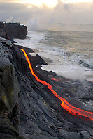 Sunrise, photographers line the sea cliff, Ocean entry lava flow, Kilauea volcano, Hawaii, USA Volcanoes National Park, The Big Island of Hawaii, USA