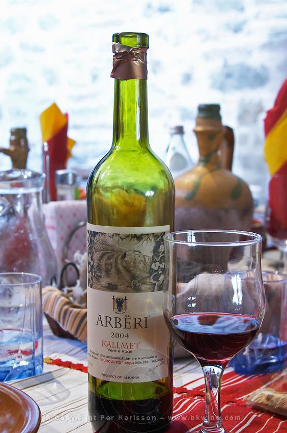 Bottle of Arberi 2004 Kallmet Vere e Kuqe, Eurogers Winery, Mirdite, and glass of red wine. Kallmet grape variety. Tradita traditional restaurant, Shkodra. Albania, Balkan, Europe.