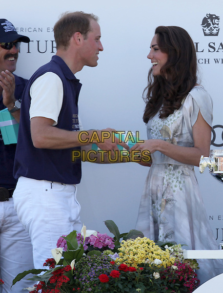 Prince William, Duke of Cambridge & Catherine, Duchess of Cambridge.The Foundation Polo Challenge Held At Santa Barbara Polo and Raquet Club, Carpenteria, California, USA, .9th July 2011..half length royal tour royalty kate middleton princess grey gray floral flower print dress cup trophy holding tiffany box giving presenting side couple husband wife married .CAP/ADM/KB.©Kevan Brooks/AdMedia/Capital Pictures.