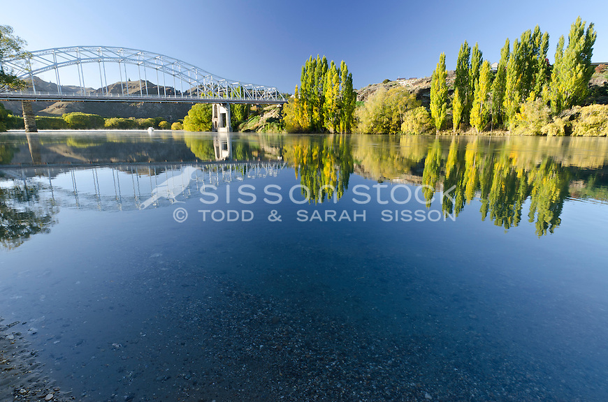 Alexandra Bridge reflected in the Clutha River in early Autumn, Central Otago