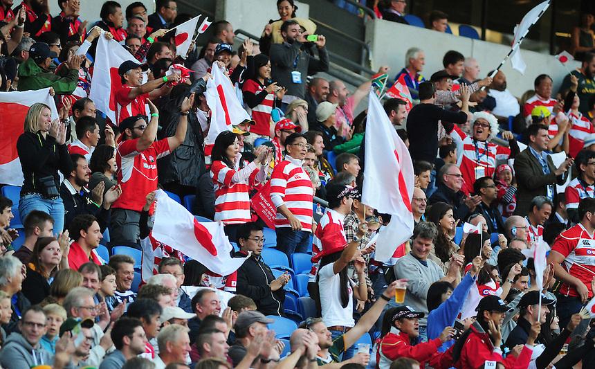 Japan fans get behind their team during todays match<br /> <br /> Photographer Kevin Barnes/CameraSport<br /> <br /> Rugby Union - 2015 Rugby World Cup - Japan v South Africa - Saturday 19th September 2015 - The American Express Community Stadium - Falmer - Brighton<br /> <br /> &copy; CameraSport - 43 Linden Ave. Countesthorpe. Leicester. England. LE8 5PG - Tel: +44 (0) 116 277 4147 - admin@camerasport.com - www.camerasport.com