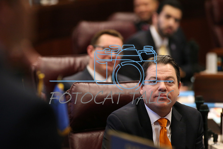 Nevada Majority Leader Michael Roberson, R-Las Vegas, listens to debate on the Senate floor at the Legislative Building, in Carson City, Nev., on Friday, Feb. 20, 2015. <br /> Photo by Cathleen Allison