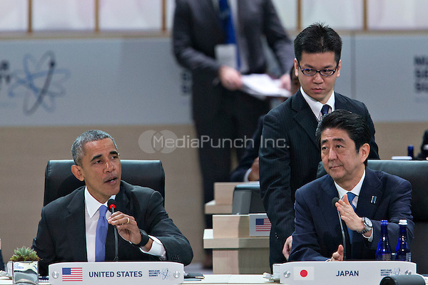 United States President Barack Obama, left, speaks as Shinzo Abe, Japan's prime minister, right, listens during an opening plenary entitled &quot;National Actions to Enhance Nuclear Security&quot; at the Nuclear Security Summit in Washington, D.C., U.S., on Friday, April 1, 2016. After a spate of terrorist attacks from Europe to Africa, Obama is rallying international support during the summit for an effort to keep Islamic State and similar groups from obtaining nuclear material and other weapons of mass destruction. <br /> Credit: Andrew Harrer / Pool via CNP/MediaPunch