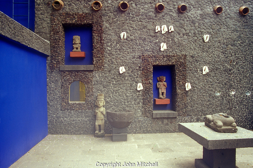 Pre-Columbian artifacts in the courtyard at the Museo Frida Kahlo, also known as the Blue House or Casa Azul, in Coyoacan, Mexico City. Mexican artist Frida Kahlo was born this house and lived in it with her husband Diego riva from 1929 until 1954.