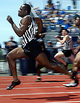 (GMC RELAYS)--26321--On Sat May 11,2002--track0511a--Old Bridge's Brandon Nolen streaks by during the boys 100 meter finals held at South Brunswick High School. (MARK R. SULLIVAN/HNT CHIEF PHOTOGRAPHER)