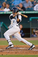Miguel Fermin #11 of the Jupiter Hammerheads follows through on his swing against the Charlotte Stone Crabs at Roger Dean Stadium June 15, 2010, in Jupiter, Florida.  Photo by Brian Westerholt /  Seam Images