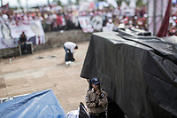 June 23, 2018: A security guard during the campaign rally of Andres Manuel Lopez Obrador, an opposition candidate of MORENA party running for presidency (not-pictured), at Xanenetla park in Puebla City, Mexico. National elections will be hold on July 1.