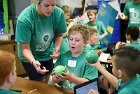NWA Democrat-Gazette/CHARLIE KAIJO Third grade teacher Kassi Harp (center left) hands Reid Smith (center) a water balloon for an activity about potential and kinetic energy during a STEM summer camp, Monday, June 10, 2019 at Bonnie Grimes Elementary School in Rogers.<br />