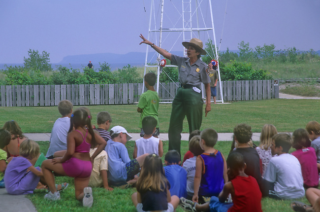 Children listen to a ranger during a Breeches Buoy demonstration at the Glen Haven Life Saving Station Museum in Slleping Bear Dunes National Lakeshore in Leelanau County, Michigan