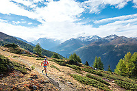 Running above Evolène during the Via Valais, a multi-day trail running tour connecting Verbier with Zermatt, Switzerland.