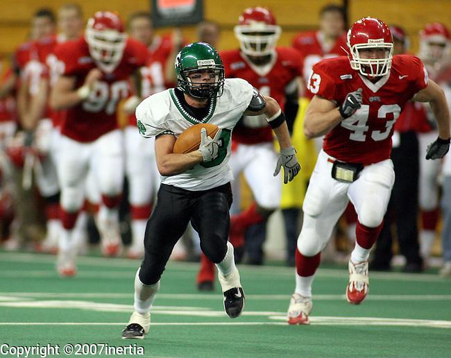 Weston Dressler #18 of the University of North Dakota picks up yardage past Zach Johnson #90, Justiss Scales #4, and Blake Hojer #43 in the fourth quarter Saturday, Novermber 10, 2007 at the DakotaDome in Vermillion. (photo by Dave Eggen/Inertia)