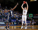 BROOKINGS, SD - FEBRUARY 4:  Mike Daum #24 from South Dakota State University shoots over Albert Owens #44 from Oral Roberts during their game Saturday afternoon at Frost Arena in Brookings.(Photo by Dave Eggen/Inertia)
