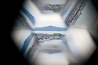 View of Rangitoto Island through a Kaleidoscope at Sky Tower, Auckland, North Island, New Zealand. Auckland, situated in the Hauraki Gulf of North Island is the largest and most populated city in New Zealand. With plenty to do within the city, and endless beautiful scenery on the surrounding islands and area just outside Auckland, it is easy to see why it is most people's first stop on a tour of New Zealand. The Sky Tower is one of the main tourist attractions in Auckland, and at 328 meters tall, is the highest building in the southern hemisphere. It offers revolving cafes, bars and restaurants, the adrenaline filled Sky Jump and Sky Walk, and unrivalled views of Auckland and the surrounding islands from the 220 meter viewing platform.