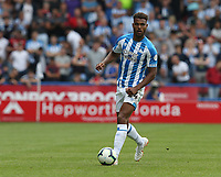 Huddersfield Town's Steve Mounie <br /> <br /> Photographer Stephen White/CameraSport<br /> <br /> The Premier League - Huddersfield Town v Chelsea - Saturday August 11th 2018 - The John Smith&rsquo;s Stadium<br />  - Huddersfield<br /> <br /> World Copyright &copy; 2018 CameraSport. All rights reserved. 43 Linden Ave. Countesthorpe. Leicester. England. LE8 5PG - Tel: +44 (0) 116 277 4147 - admin@camerasport.com - www.camerasport.com