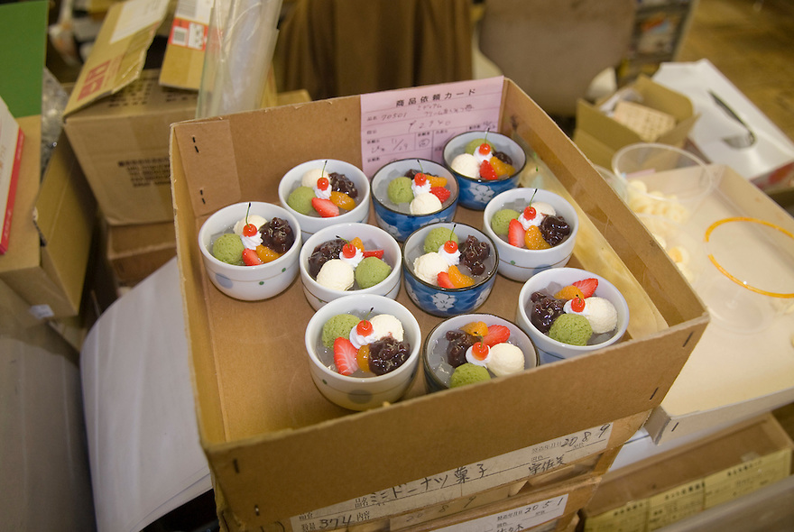 Plastic Japanese desserts in an office at Maiduru Corporation, Tokyo, Japan, 22nd December 2008. Maiduru corporation makes highly realistic plastic food for display in restaurant and cafe windows. .