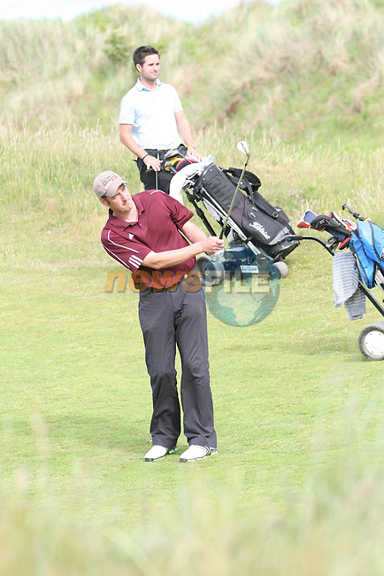 Alec Dignam of Skerries Golf Club hitting onto the 3rd green on day 2 of the 2010 East of Ireland Amateur Golf Competition in Co.Louth Golf Club...Photo NEWSFILE/Jenny Matthews.(Photo credit should read Jenny Matthews/NEWSFILE)....This Picture has been sent you under the condtions enclosed by:.Newsfile Ltd..The Studio,.Millmount Abbey,.Drogheda,.Co Meath..Ireland..Tel: +353(0)41-9871240.Fax: +353(0)41-9871260.GSM: +353(0)86-2500958.email: pictures@newsfile.ie.www.newsfile.ie.FTP: 193.120.102.198.