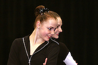 (L-R) Galina Shyrkina and Anna Bessonova of Ukraine finish duet gala exhibition at San Francisco Invitational on February 11, 2006. Bessonova won All-Around competition. (Photo by Tom Theobald)