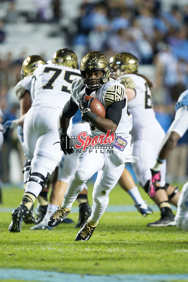 Tyler Bell (27) of the Wake Forest Demon Deacons looks for running room during first half action against the North Carolina Tar Heels at Keenan Stadium on October 17, 2015 in Chapel Hill, North Carolina.   (Brian Westerholt/Sports On Film)