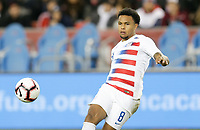 TORONTO, ON - OCTOBER 15: Weston McKennie #8 of the United States passes off the ball during a game between Canada and USMNT at BMO Field on October 15, 2019 in Toronto, Canada.