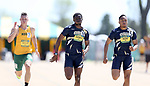 FARGO, ND - MAY 13: Omeiza Akerele from Oral Robers leads teammate D'Khari Hicks down the stretch of the men's 200 meter dash Saturday at the 2017 Summit League Outdoor Track Championship at the Ellig Sports Complex in Fargo, ND. (Photo by Dave Eggen/Inertia)