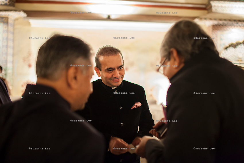 Nirav Modi (center) shares a conversation with other guests at the OzFest Gala Dinner in the Jaipur City Palace, in Rajasthan, India on 10 January 2013. Photo by Suzanne Lee