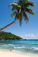 Seychelles, Island Mahe, Anse Takamaka: woman at beach, west coast<br />
