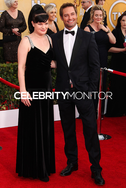 LOS ANGELES, CA - JANUARY 18: Pauley Perrette, Josh Holloway at the 20th Annual Screen Actors Guild Awards held at The Shrine Auditorium on January 18, 2014 in Los Angeles, California. (Photo by Xavier Collin/Celebrity Monitor)