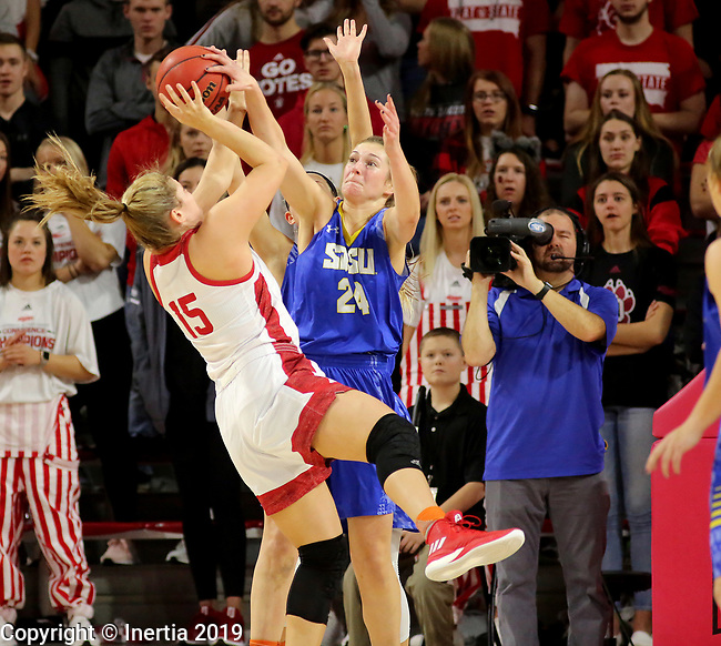 VERMILLION, SD - JANUARY 6: Tagyn Larson #24 from South Dakota State University blocks the shot of Taylor Frederick #15 from the University of South Dakota during their game Sunday afternoon at the Sanford Coyote Center in Vermillion, SD. (Photo by Dave Eggen/Inertia)