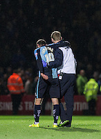 Michael Harriman of Wycombe Wanderers is carried off with cramp during the Sky Bet League 2 match between Wycombe Wanderers and Portsmouth at Adams Park, High Wycombe, England on 28 November 2015. Photo by Andy Rowland.