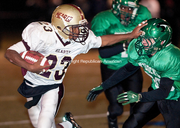 WATERBURY, CT, 23 NOVEMBER 2011-112311JS07- Sacred Heart's Jolly Black (23) stiff arms Wilby's Ryan Nevers (89) on his way for a touchdown during their 39-34 win over Wilby Wednesday at Municipal Stadium in Waterbury. <br />  Jim Shannon Republican-American