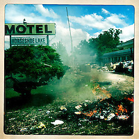 Fires burning debris at Horseshoe Lake Motel in Olive Branch, Ill., on May 21, 2011.
