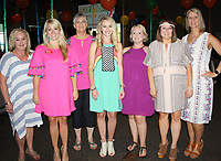 NWA Democrat-Gazette/CARIN SCHOPPMEYER Darcy Smith (from left), Kelsey Tapp, Kathy Crisp, Kalee Cooper, Megan Cuddy, Crystal Butler an Julia Brooks, Summer Salsa committee members welcome guests to the 15th annual Children's House benefit June 17 at the Fayetteville Town Center.